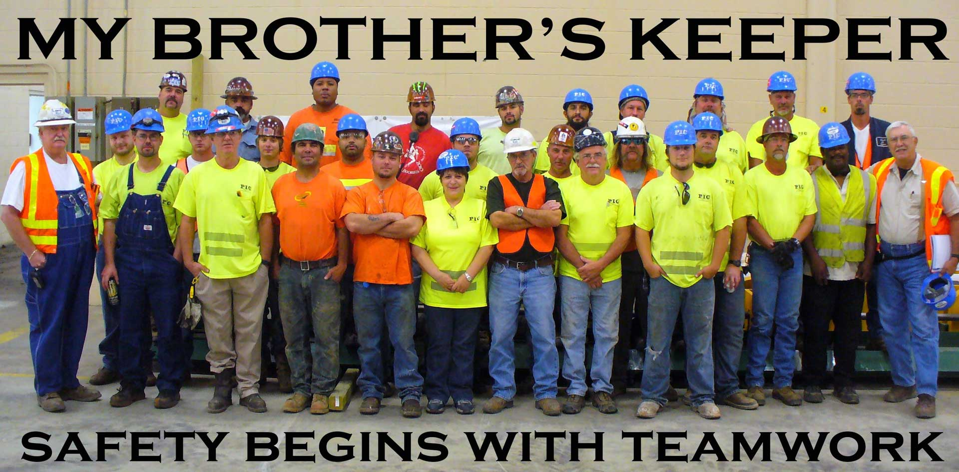 """Picture of the PIC employees standing in a line, with words above and below saying """"My brother's keeper: safety begins with teamwork"""""""